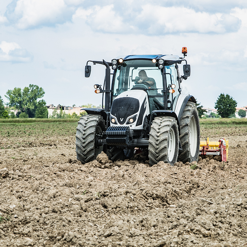 valtra a series tractor on field in mud